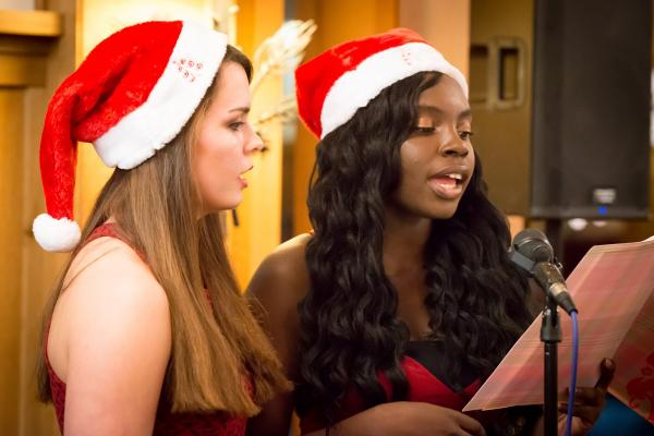 students sing holiday carols